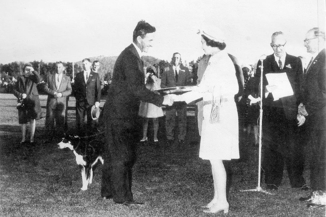 Queen Elizabeth presenting 1970 National Sheep Dog Champion